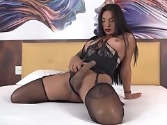 Wendy's hot friend Janny Costa in black lingerie jacking off her massive dick