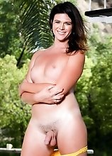 Kendall loves coating herself in oil. Just standing out there in the hot sun drenching herself feels so good. Her big firm tranny titties love baking