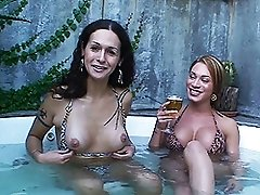 TS pornstars giving an interview in the jacuzzi