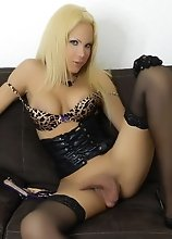 A Blonde Bombshell in lingerie with gloves and stockings