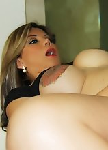 Busty Tranny shoves 2 DILDOS in 1 HOLE