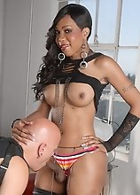 Horny ebony transsexual using a guy to please her