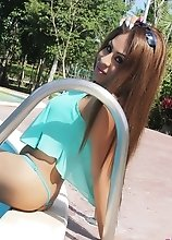 Hung Tranny stroking outdoors in several sexy outfits